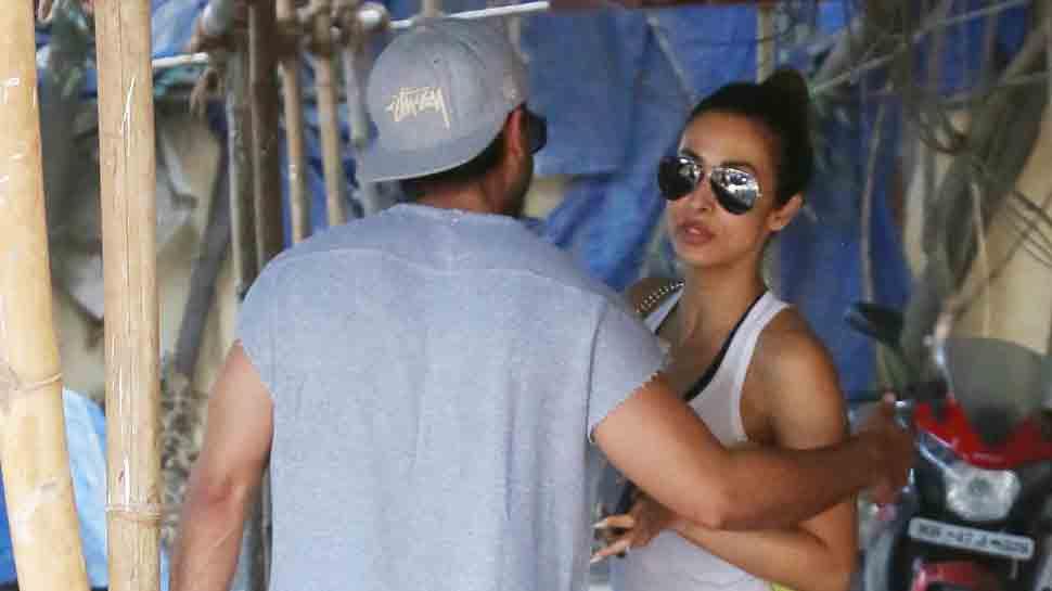 Shahid Kapoor bumps into Malaika Arora at his gym and they greet with a warm hug