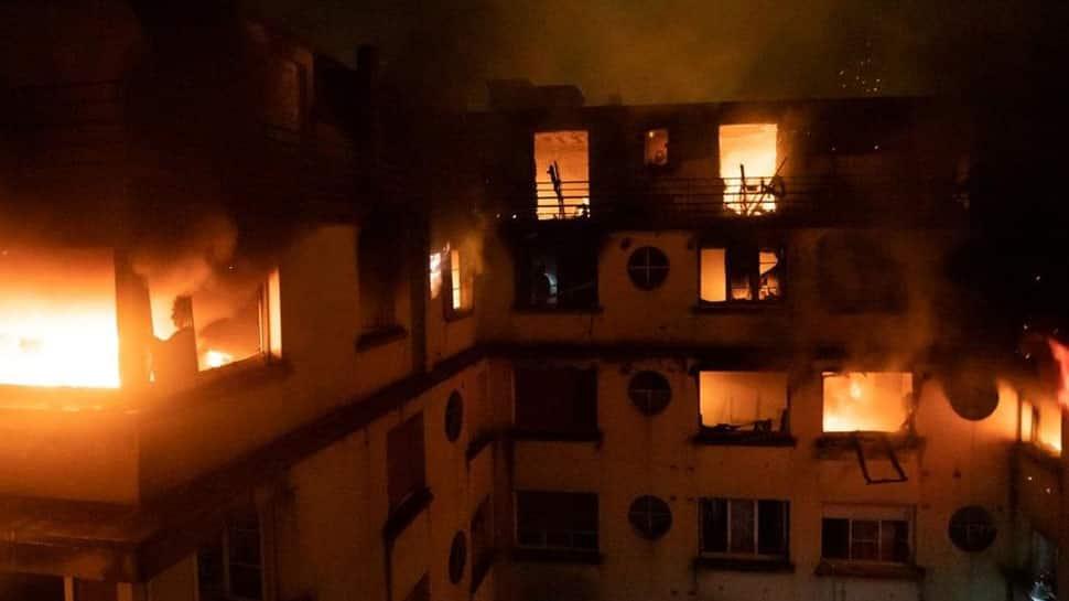 Blaze kills 10 in Paris apartment block, arson suspected