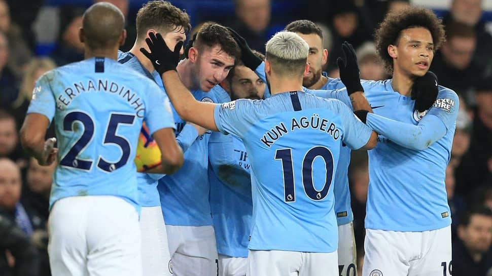 Manchester City go top of the Premier League with win at Everton