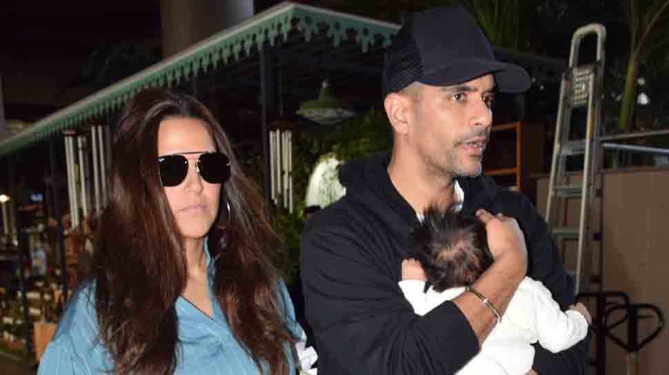 Neha Dhupia, Angad Bedi spotted at airport with daughter Mehr — Pics