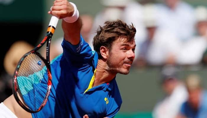 Wawrinka outlasts good friend Paire