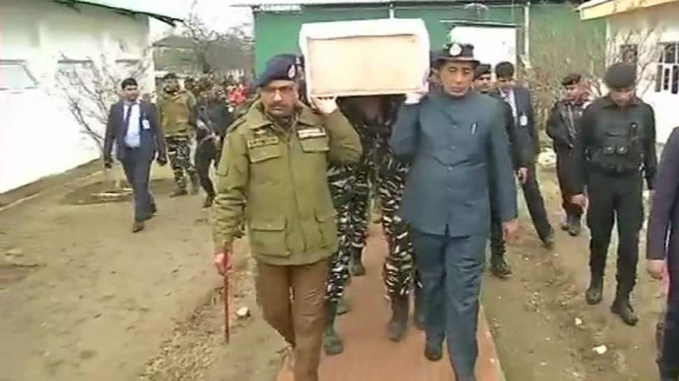 Home Minister Rajnath Singh lends his shoulder to CRPF soldier's mortal remains