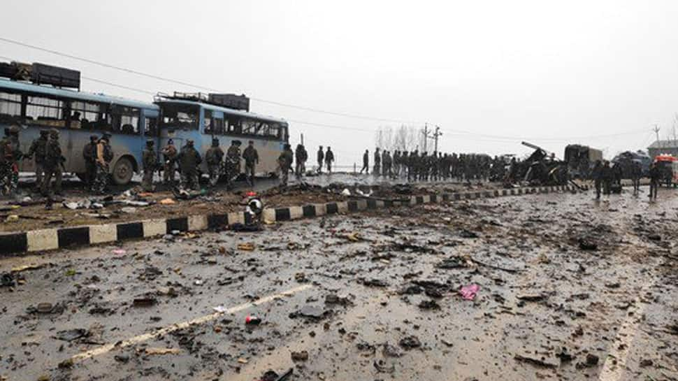 Uttarakhand CM Trivendra Singh Rawat pays tribute to slain CRPF jawan in Dehradun