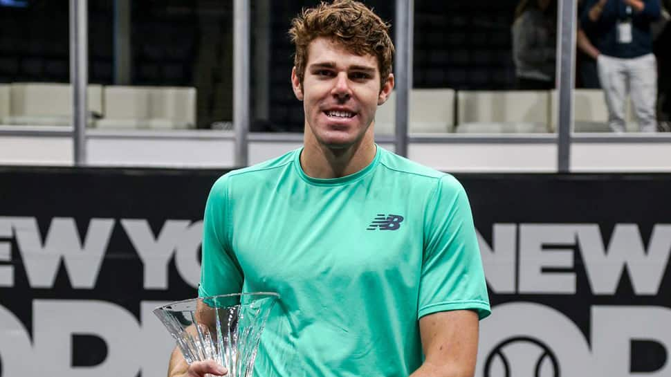 Reilly Opelka earns first Tour title with New York Open win over Brayden Schnur