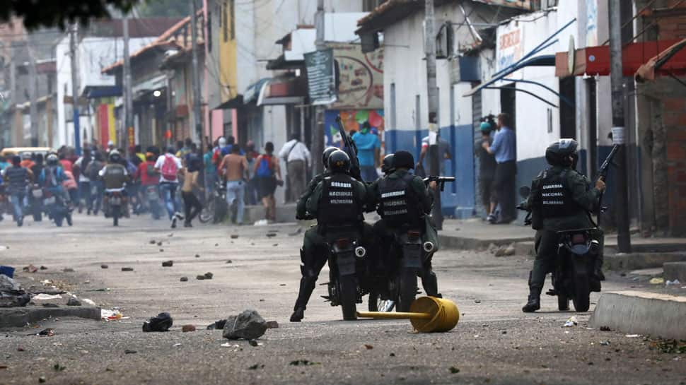 Venezuela protests flare, soldiers defect ahead of border aid operation
