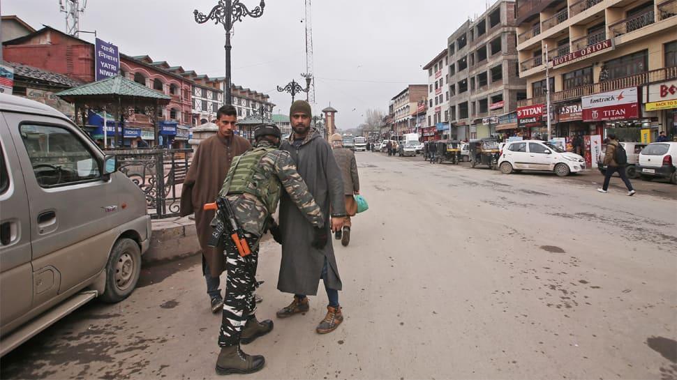 Raids, stocking of essentials creates panic in Kashmir; J&K Governor urges calm