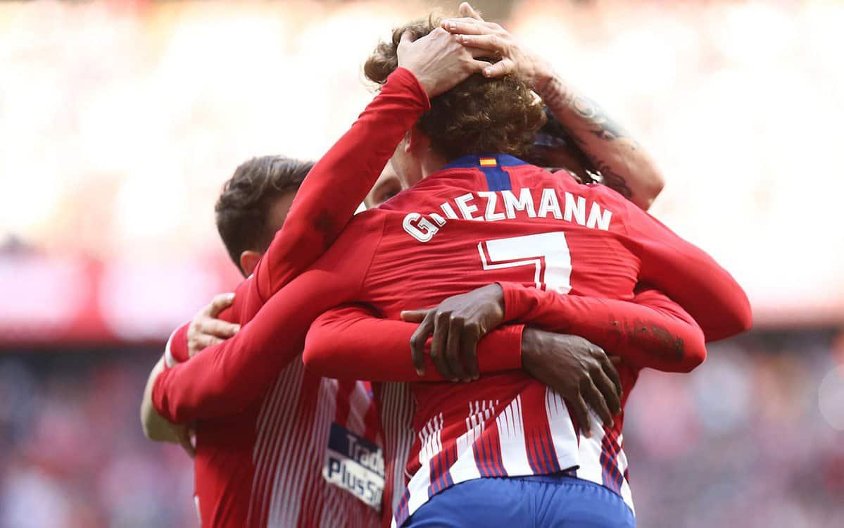 Alvaro Morata's brace keeps up 10-man Atletico Madrid's Barca chase