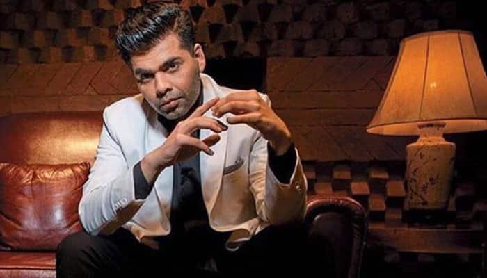 Karan Johar faces flak over an anti-SRK tweet, apologizes
