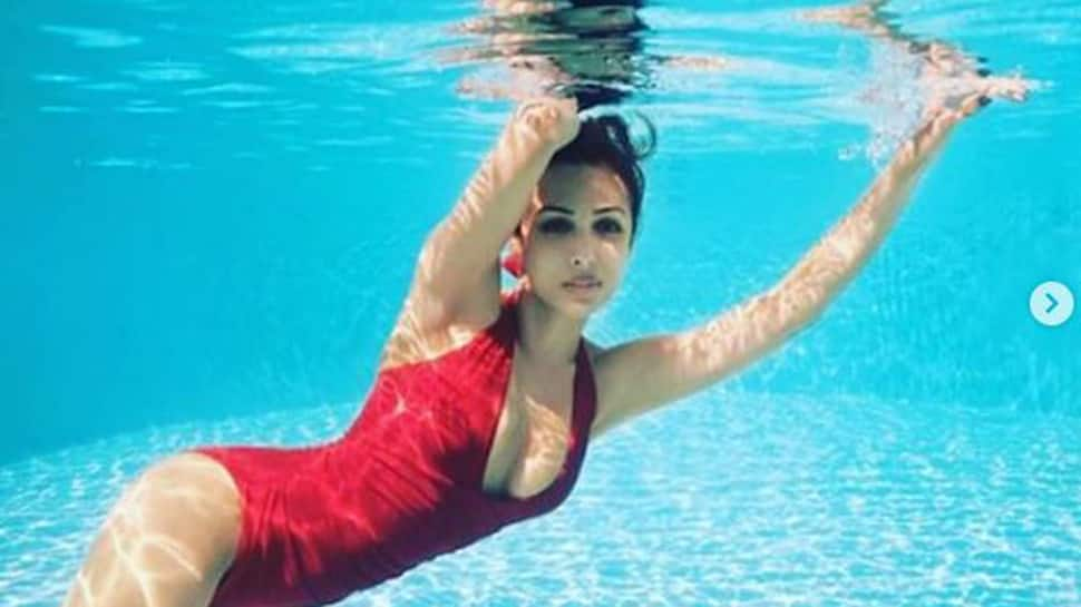 Malaika Arora sizzles in a red flaming monokini-See pics