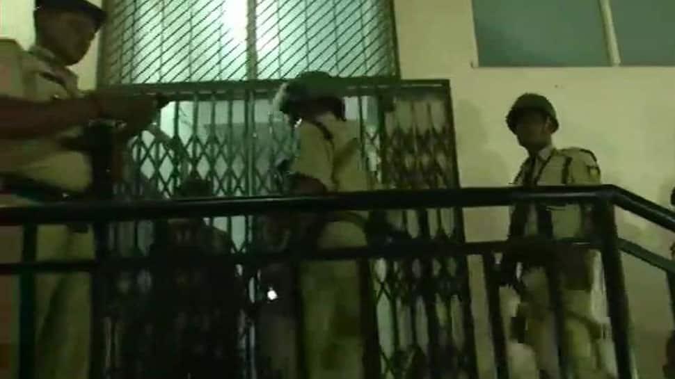 I-T searches: Cops, CRPF personnel argue outside Ashwin Sharma's apartment