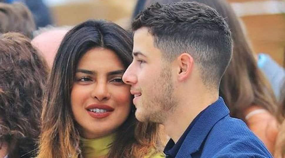 Priyanka Chopra trips, clasps Nick's arm, avoids fall
