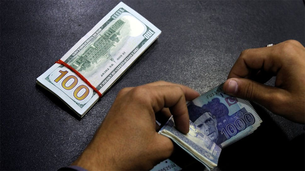 Pakistani currency tumbles but finance minister focuses on critics