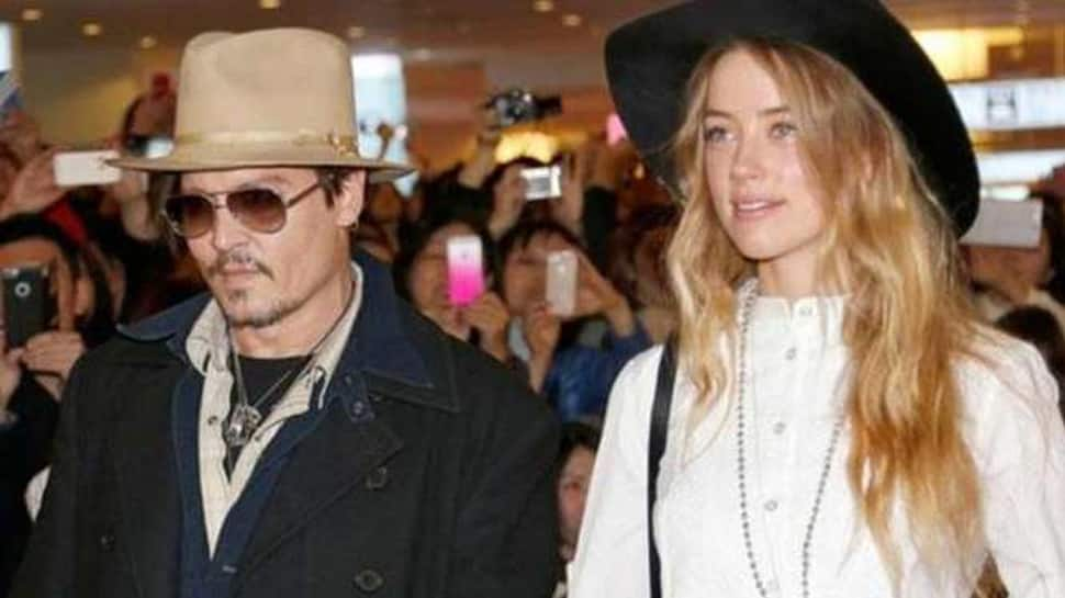 Amber Heard claims Johnny Depp threatened to kill her