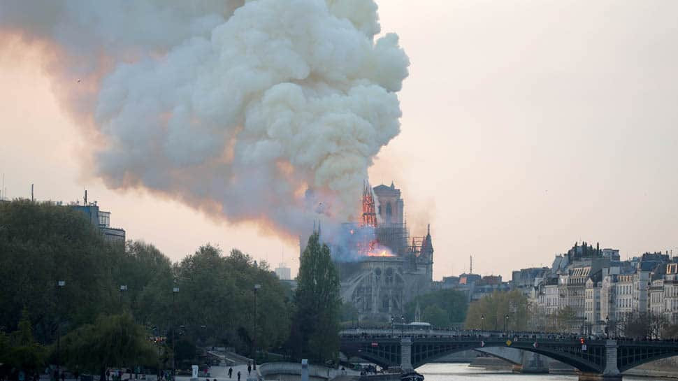 Fire guts Notre-Dame Cathedral in Paris, French President Emmanuel Macron pledges to rebuild
