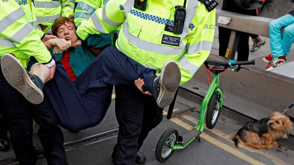 London climate-change street protest arrests reach 290 on second day