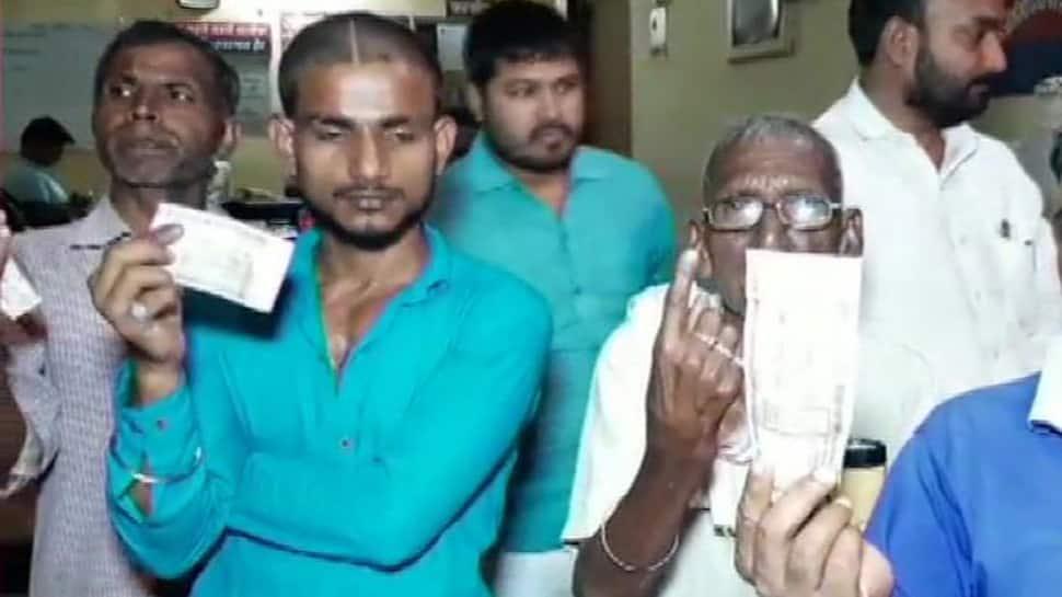 BJP workers forcefully applying ink on fingers of Dalit voters in Uttar Pradesh's Chandauli: SP