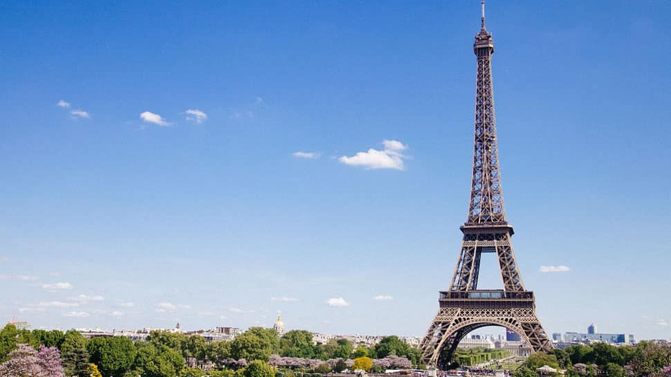 France: Eiffel Tower evacuated after man tries to scale it, monument closed for visitors