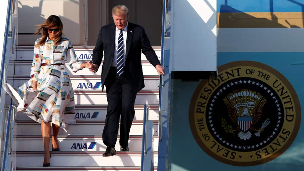 US President Donald Trump arrives in Japan for ceremonial visit as trade tensions loom