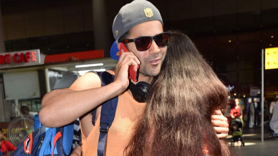 Varun Dhawan meets crazy fans at airport, poses for clicks—See pics