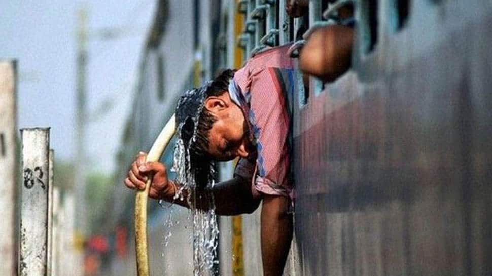 Delhi continues to grapple with heatwave, IMD issues 'red' warning