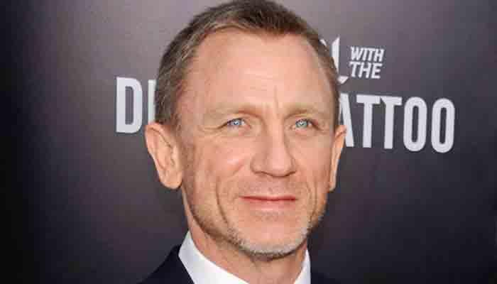Daniel Craig sweats it out with leg cast following injury on sets of 'Bond 25'