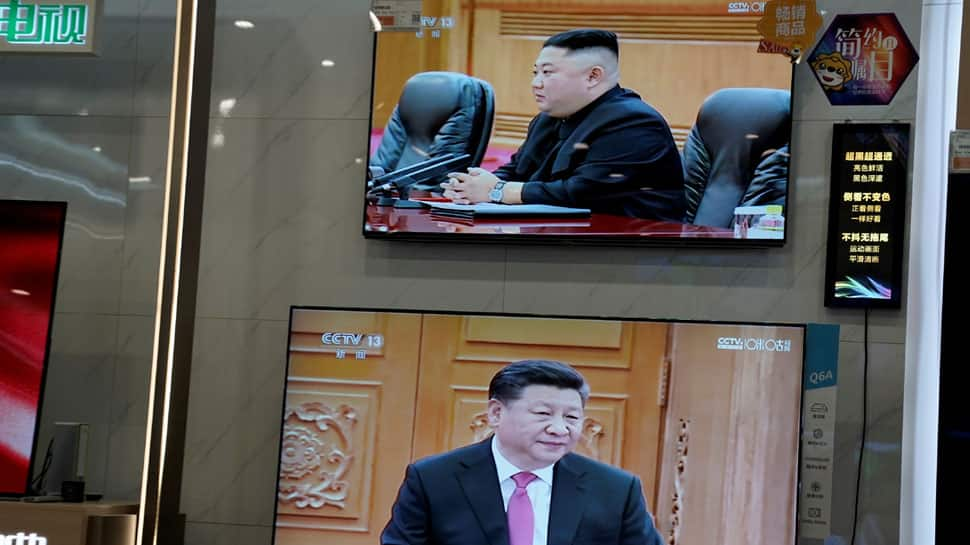 China's Xi Jinping arrives in North Korea with senior economic official in tow