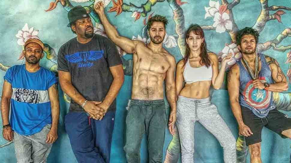 Varun Dhawan, Nora Fatehi show off abs in new still from 'Street Dancer' sets