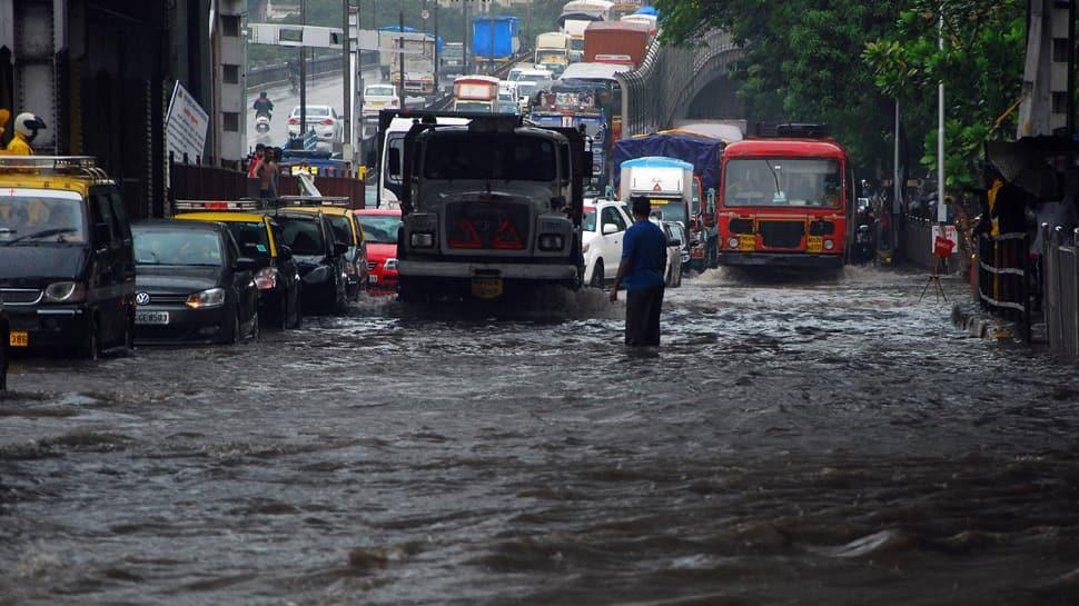 Heavy rains kill 3, injure 2 in Mumbai; trigger traffic snarls, train cancellation