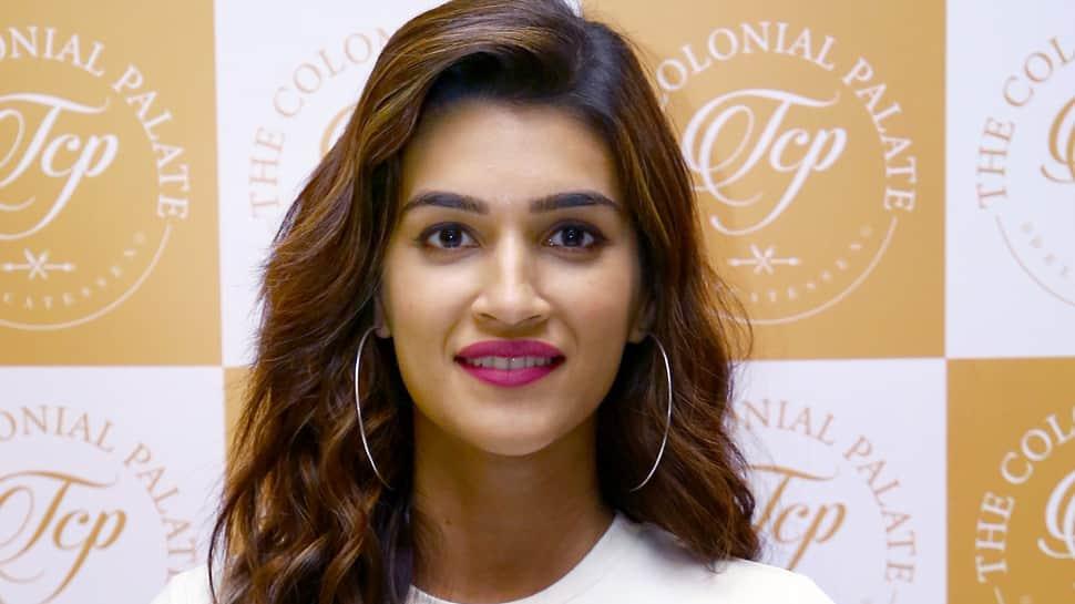 Kriti Sanon looks uber chic in a white tee and wrap-around skirt—Pics