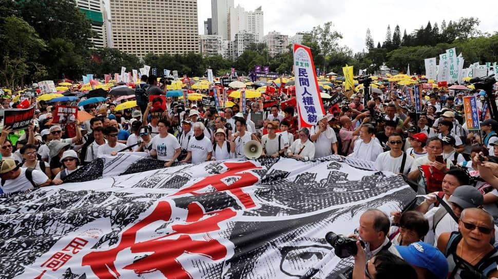 Britain tells China to honour Hong Kong freedoms