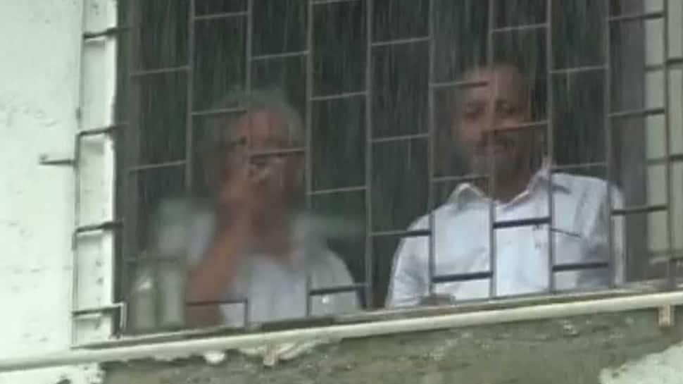 CPI(M) General Secretary Sitaram Yechury smokes inside court premises