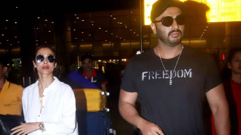 Vacation over, Arjun Kapoor and Malaika Arora touchdown in Mumbai - Pics