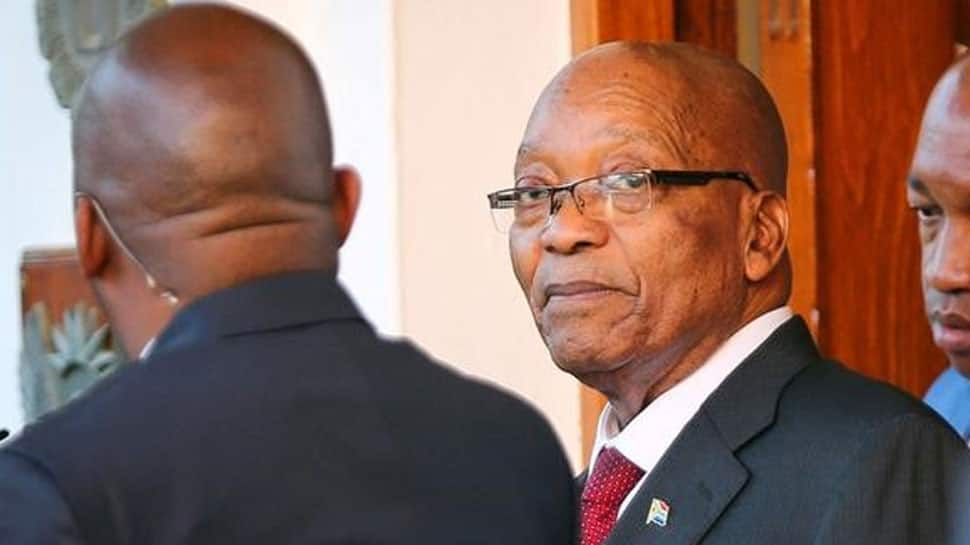 South Africa's Zuma denies breaking law with business brothers