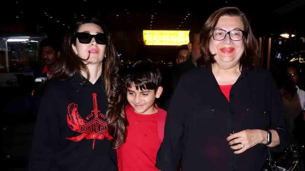Karisma Kapoor flies back from London with children, twins with mother Babita in black — Pics inside