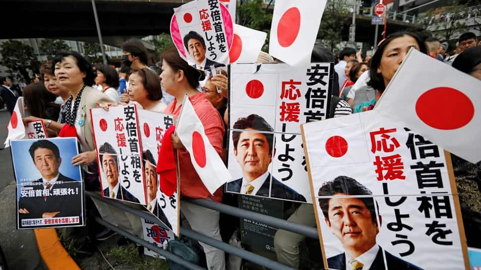 Shinzo Abe secures majority in Japan election