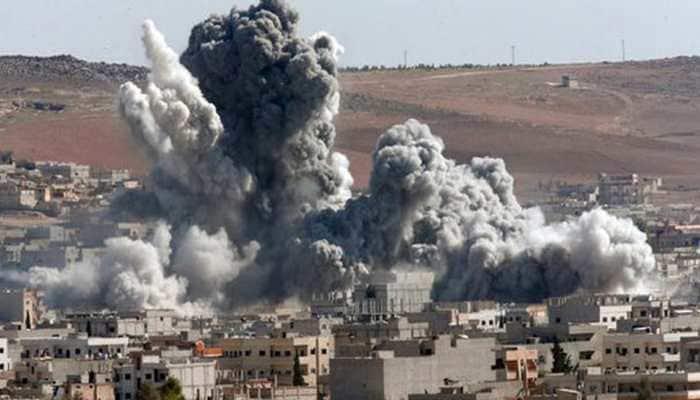 At least 32 killed in air strikes in rebel-held city in Syria, say rescuers