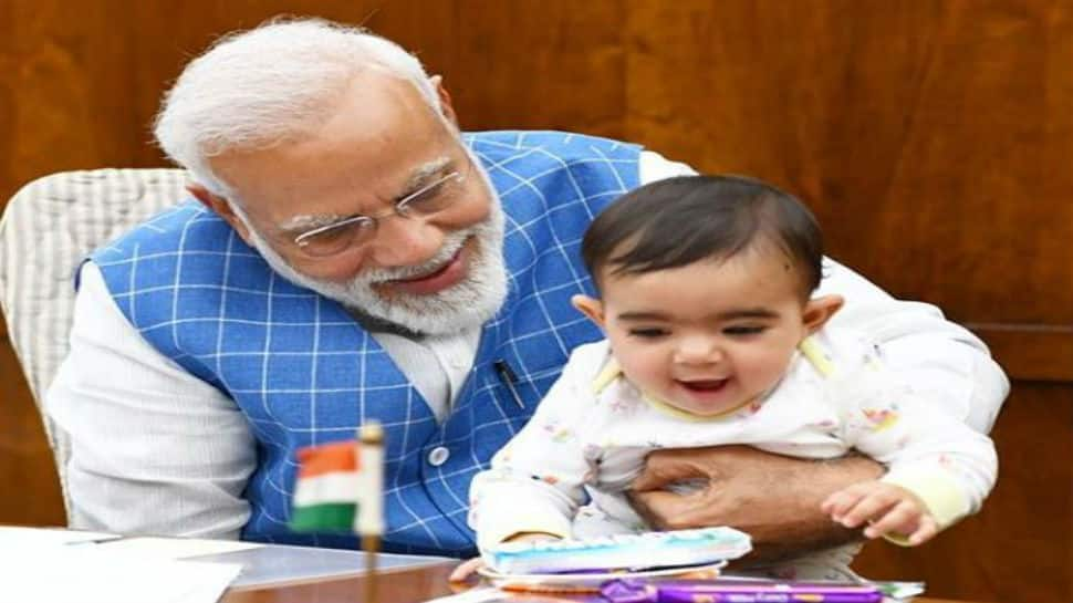 Photos of PM Narendra Modi playing with baby in Parliament go viral