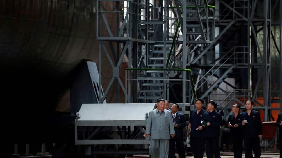 North Korean leader Kim Jong Un inspects new submarine, signals possible ballistic missile development