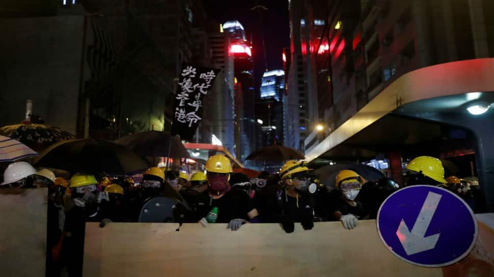 China urges end to Hong Kong protests, backs regional leader