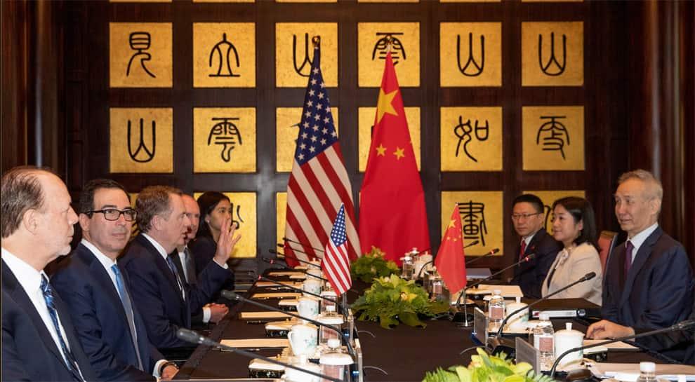 Top US, Chinese officials meet in bid to end year-long trade war amid Trump's tough talks