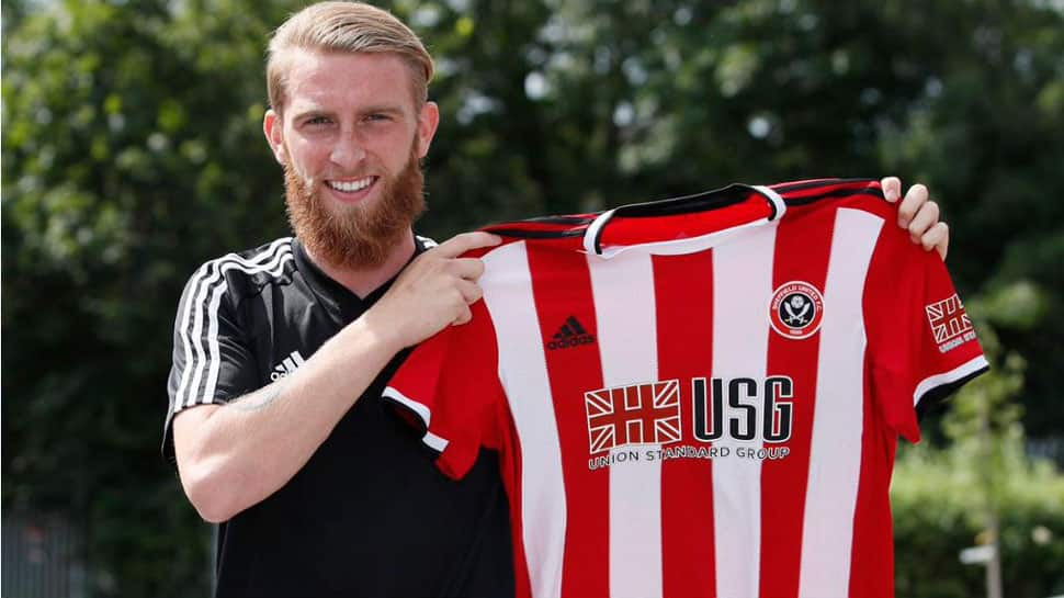 Sheffield United sign Oli McBurnie from Swansea City in a club-record deal
