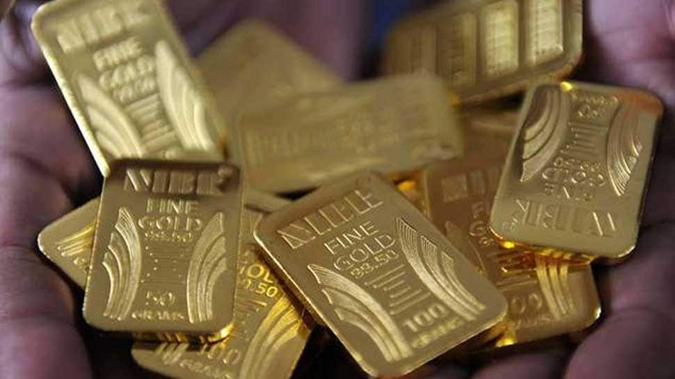 Gold touches record high of Rs 36,327 after Trump's tariff threat sparks rally