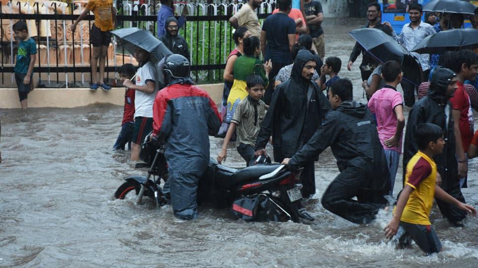 After red alert over Mumbai rains, Maharashtra CM Devendra Fadnavis says 'government working with BMC'