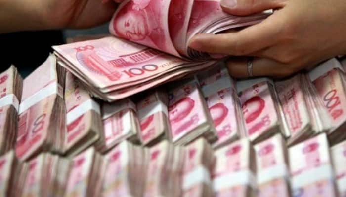 China lets yuan break key seven level for first time in decade as trade war worsens