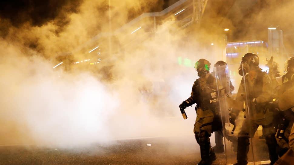 Hong Kong police fire tear gas at protestors as strikes paralyse city