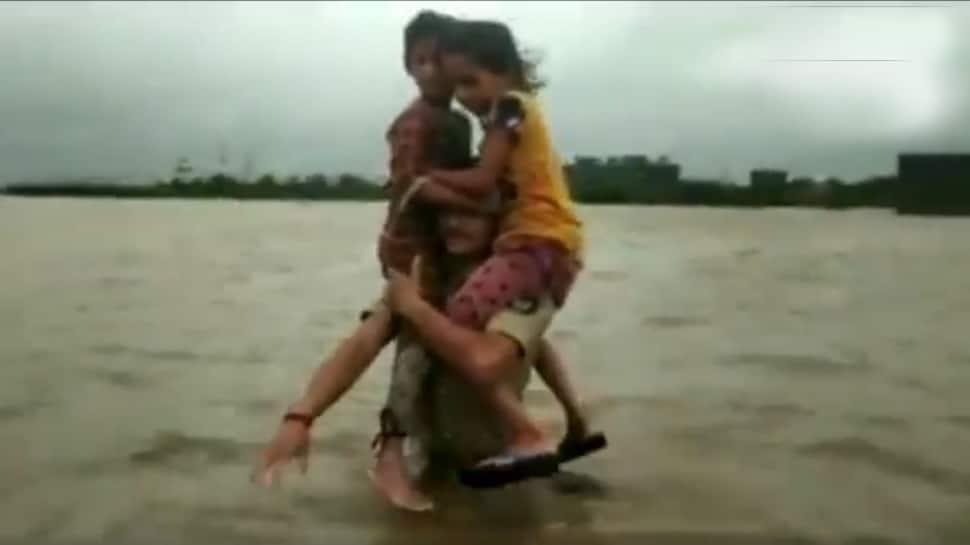 Watch: Brave constable Pruthviraj Jadeja carries two children on shoulders for 1.5 km in flood-hit Gujarat village