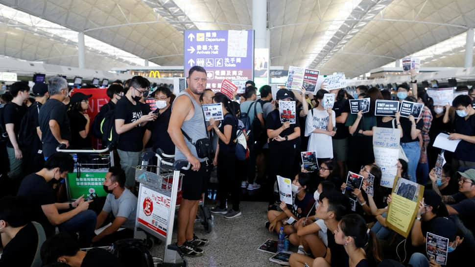 China says Hong Kong protests show 'sprouts of terrorism'; airport reopens
