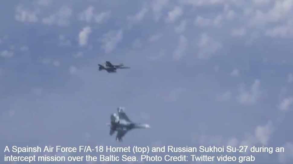 Sukhoi Su-27 fighters chase away Spanish Air Force F/A-18 Hornet as it tries to intercept Russian Defense Minister Sergei Shoigu's plane