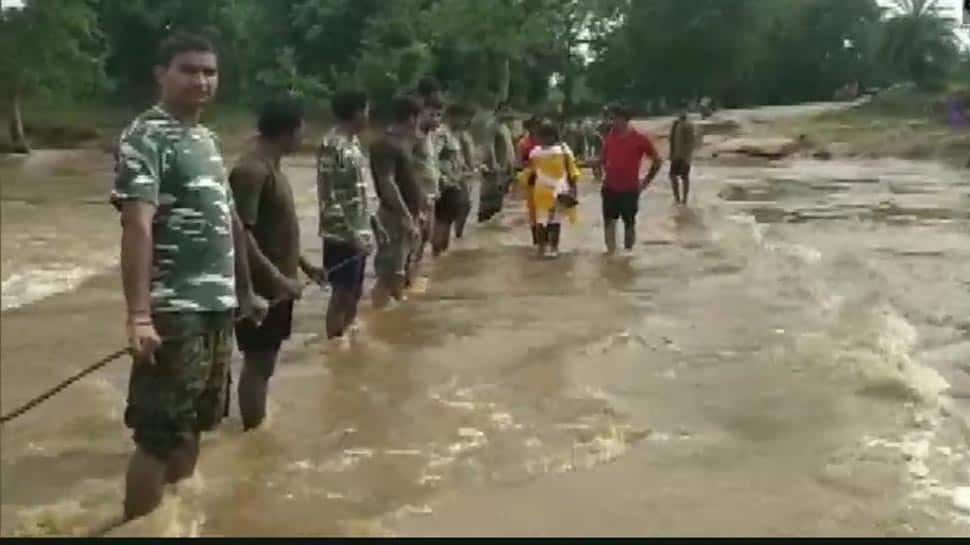 CRPF jawans form human chain to assist people in flood-hit Chhattisgarh's Sukma