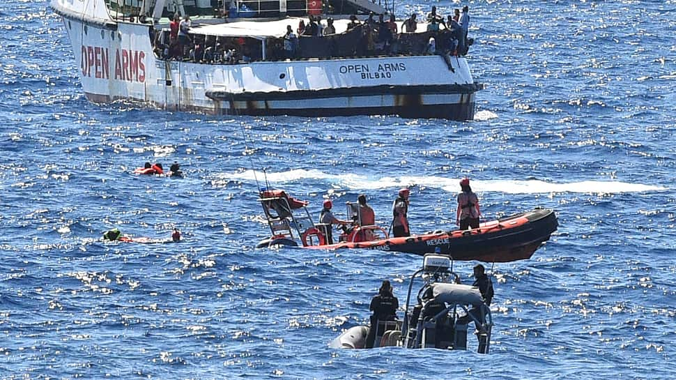 Tensions rise after 10 jump from migrant ship stranded off Italy